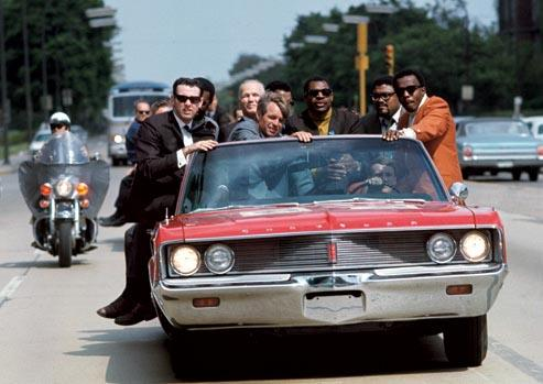 Bobby Kennedy campaigns in IN during May of 1968, with various aides and friends:  former prizefighter Tony Zale and (right of Kennedy) N.F.L. stars Lamar Lundy, Rosey Grier, and Deacon Jones<br/>