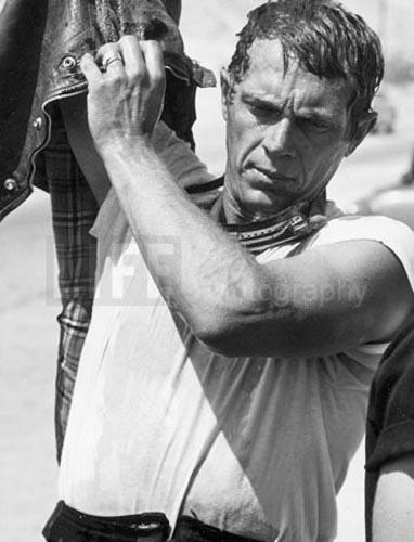 Steve McQueen after motorcycle race, Mojave Desert, 1963<br/>
