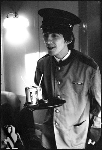 George wearing Train Porter's Jacket. Train to D.C. Feb 10, 1964. Copyright Bill Eppridge