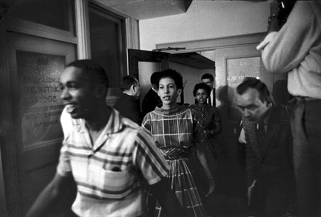 The Little Rock Nine enter classroom to register after escort from Army's 101st Airborne Division, September 24, 1957