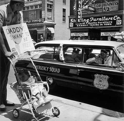 William Edwin Jones pushes daughter Renee Andrewnetta Jones (8 months old) during protest march on Main St., Memphis, TN (The little girl grew up to become a doctor) August, 1961
