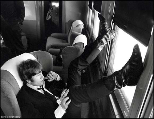 John Lennon on the train from New York to Washington for the Beatles' concert at Washington Coliseum, Feb. 11, 1964