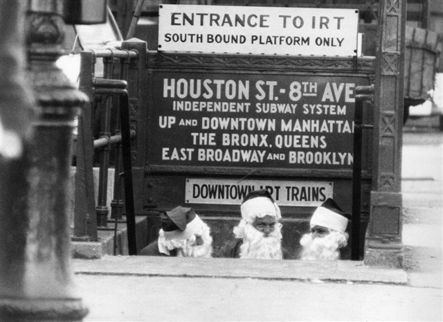 Three Santa Clauses leaving Downtown IRT Subway, New York, 1958